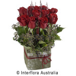 12 red roses arranged into a box